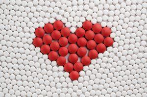 Red pills forming heart symbol