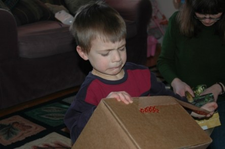 Opening a package - he did get it open!