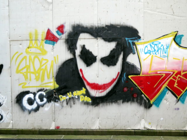 Why wouldn't you expect graffiti of Heath Ledger's Joker on a construction site in Shanghai's Old City? Shanghai, China, Asia.