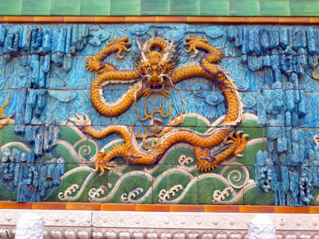 One of the dragons on the Forbidden City's Nine Dragon-Wall. Forbidden City, Beijing, China, Asia.