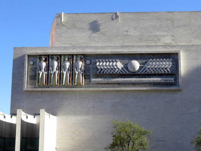 Directly across from Grace Cathedral, the Nob Hill Masonic Center. The 4 figures on the left of the frieze by Emile Nomann represent the 4 armed services. The opposing forces on the right represent the tug of war between good and evil. San Francisco, United States, North America.