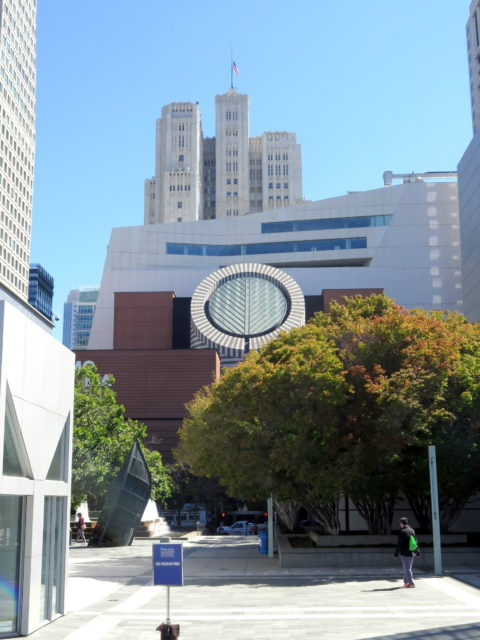 Directly across from Yerba Buena Gardens to the east, one of San Francisco's most recognizable buildings, San Francisco Museum of Modern Art. The 2016 expansion rises up directly behind it. Beyond that is the Art Deco Pacific Telephone Building, 1925. SFMOMA, San Francisco, United States, North America.
