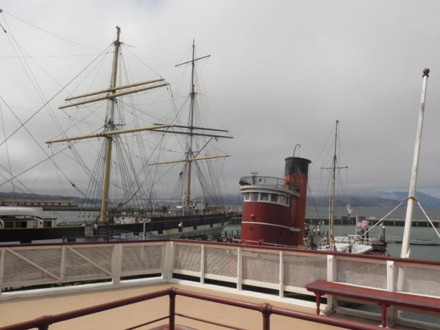 The Balclutha and Hercules, seen from the deck of the ferry Eureka on the Hyde Street Pier at San Francisco Maritime National Historical Park. San Francisco, United States, North America.
