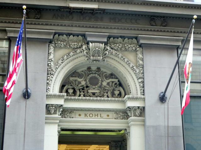 The truly exquisite detail above the entrance to the Kohl Building. The building was developed in 1901 by Alvinza Hayward, who made many fortunes off of silver and gold. Capitalist C. Frederick Kohl bought the building in 1904 and put his mark on it. Due to unusually sturdy construction for the time, the building survived the 1906 earthquake and fire with minimal damage. San Francisco, United States, North America.
