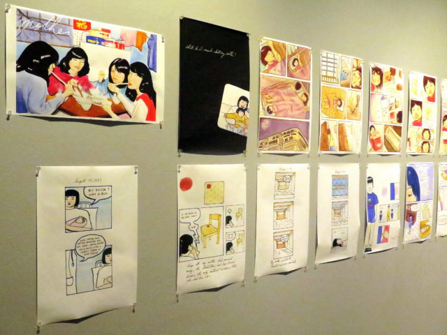 In this exhibit at 41 Ross, comic artist Kayan Cheung-Miaw illustrates the story of her life from being born in Hong Kong to growing up in New York's Chinatown. San Francisco, United States, North America.