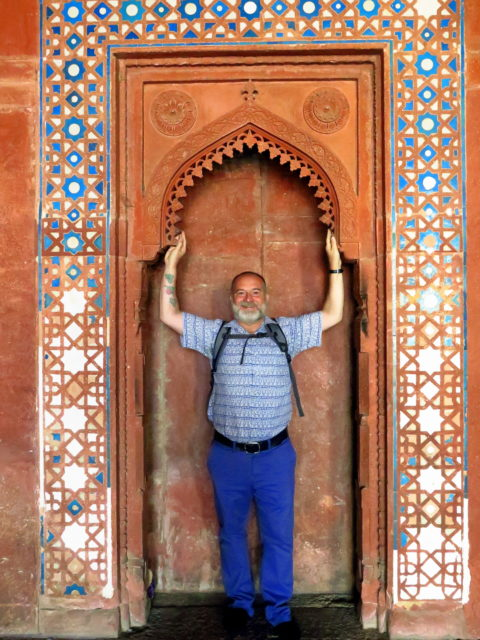 Posing at the mosque at Fatehpur Sikri, outside Agra. Fatehpur Sikri, Agra, India, Asia.