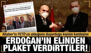 Ahaber'in FETÖ'cü olduğunu duyurduğu kişinin kardeşine Erdoğan'ın elinden plaket verdirdiler!