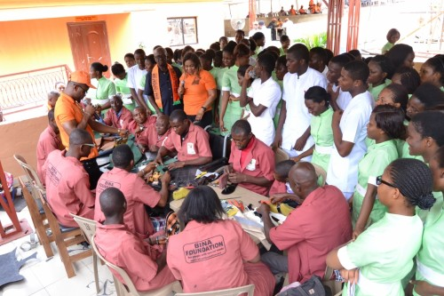 Student nurses admire the dexterity of Bina students with disability in the Leather works department