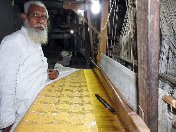 A handloom weaver at work in one of the factories