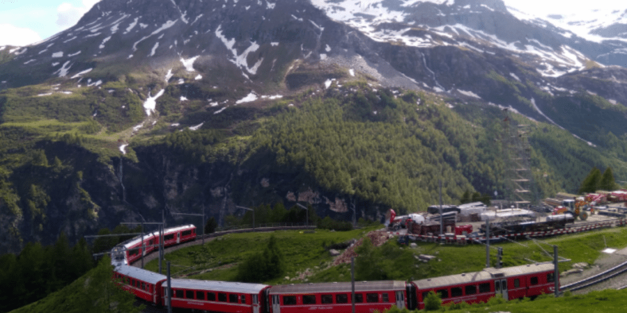 Rhaetian Railway in the Albula Bernina Landscapes at Alp Grum in Switzerland.