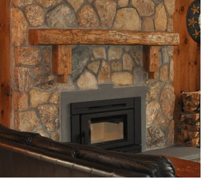 Live Edge Mantle mounted on a stone fileplace