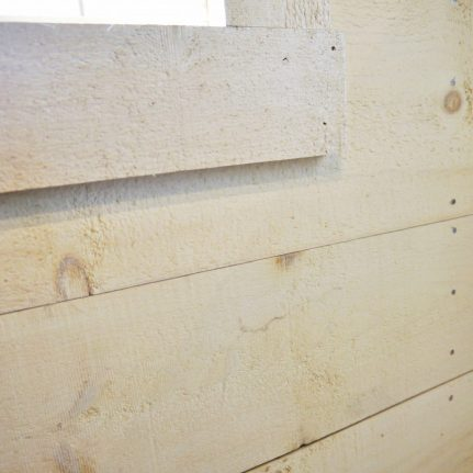 Our Pine Shiplap Wall Paneling finished with a white wash.