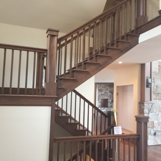 Dark stair case with rustic color
