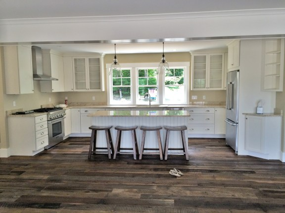 This Kitchen Island looks beautiful surrounded by the Reclaimed Kendall Road Flooring.