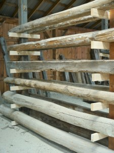 Reclaimed barnwood beams in our reclaimed beam annex