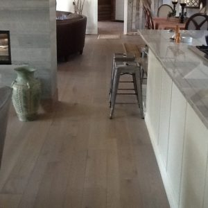 This Classic Plank White Oak Flooring was finished with a contemporary Rubio Monocoat Finish.