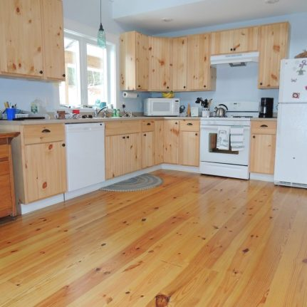 Wide Plank Long Leaf Heart Pine Flooring with a tung oil finish.