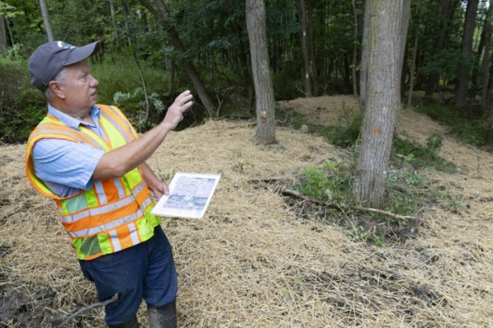 Joe Graney, (pictured here), professor of geological sciences and environmental studies and the associate director of the Center for Integrated Watershed Studies, gives a tour to show the progress of the restoration of the erosional channel at Nuthatch Hollow, Friday, September 17, 2021.