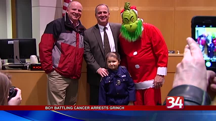 Young Ithaca officer arrests The Grinch- saves Christmas_43240451