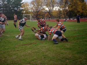 Junior scrum half Rafi Schulman looks to get the pass off to junior eight man Nick Coppola in BU's 44-13 win over Syracuse on October 18th.