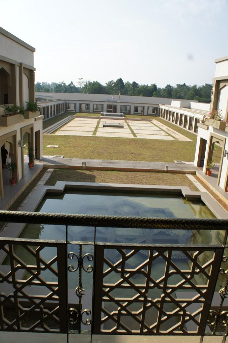 The school is built looking inward toward a large field.