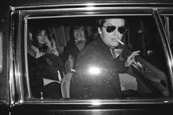 After an inauguration party for Jimmy Carter, Jack Nicholson, with Linda Ronstadt and Carl Bernstein, leave Pisces Disco in Washington D.C., on January 20, 1977