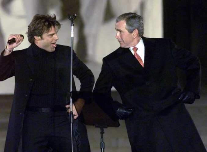 George W. Bush dances with Ricky Martin at the opening ceremony of the inauguration at the Lincoln Memorial on January 18, 2001