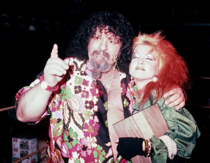 Lou Albano and Cyndi Lauper attend the Ugliest Bartender Contest Benefiting the Multiple Sclerosis Society on December 11, 1984, at Studio 54 in New York City