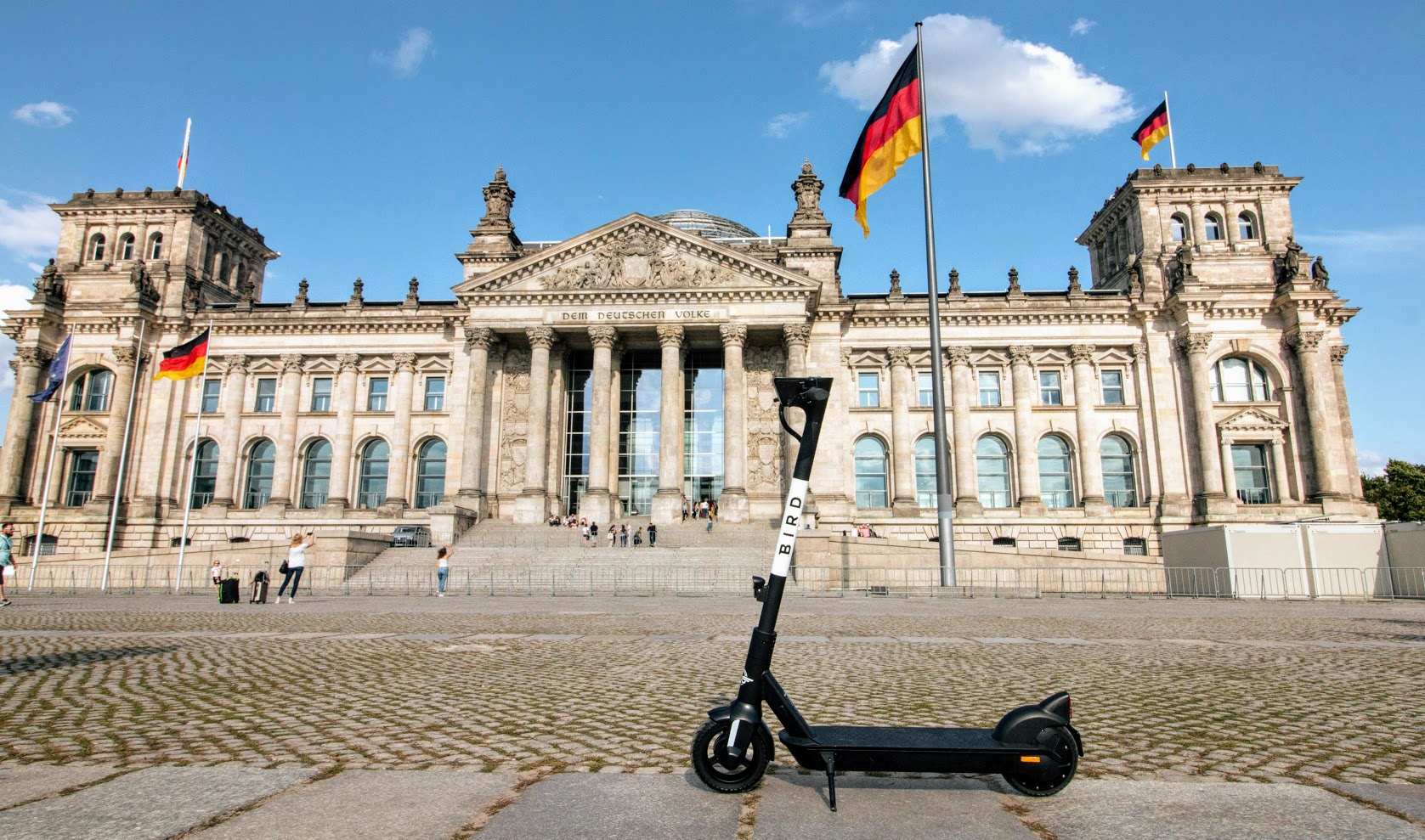 Bird electric scooter in Berlin, Germany in front of a famous building