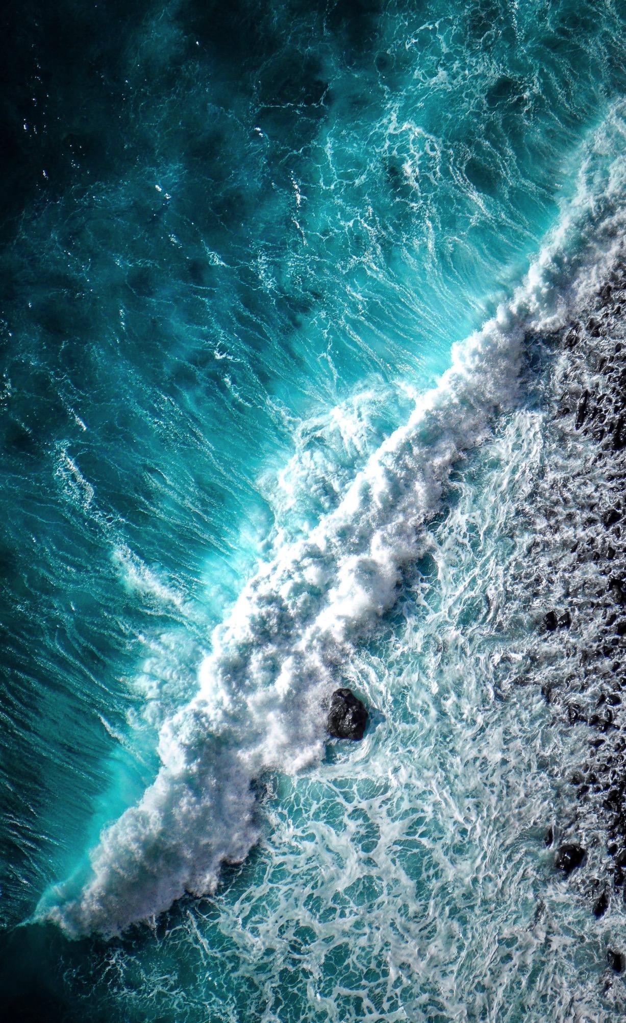 Aerial image of a wave crashing