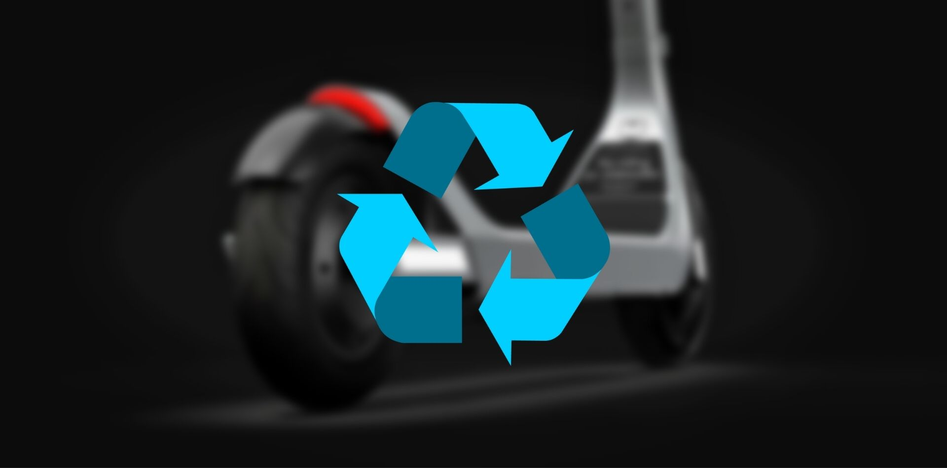 Recycling symbol on top of vehicle blurred in background