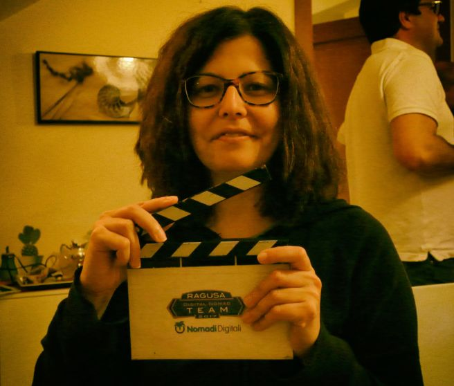 Eleonora with the clap board