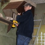 Ray Hales installing a new Sony camera in a chough nest box. Photo by Alison Hales