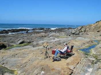 Sitting on rocks by the ocean