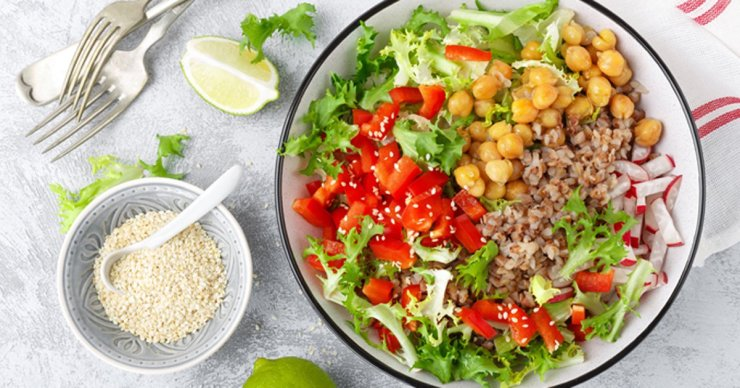 a bowl of lettuce and chickpeas