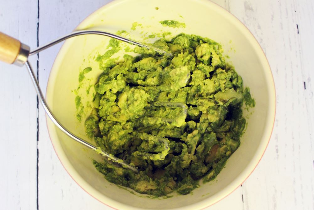 avocadoes mashed for no onion guacamole 1