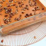 angled view of walnut topped healthy crustless pumpkin pie 1