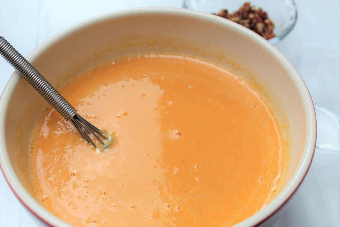 whisk eggs and spices into healthy crustless pumpkin pie 1