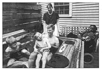Enjoying the hot tub are Aaron Bissell, at left, and his brother Eric, who is held by their father, Rich Bissell. Behind them are Cindy Bissell and Anthony Bissell. Photo by Virginia Campbell