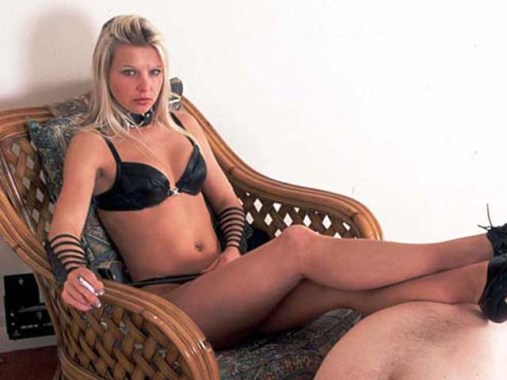 Awesome Blond Mistress Uses naked slave as Human Footstool and Ashtray