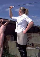 Blond Riding Domina in High Heels Whips and Humiliates Her naked slave