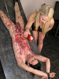 Gorgeous Blond Domina Torments Her slave with Wax on the Torture Table