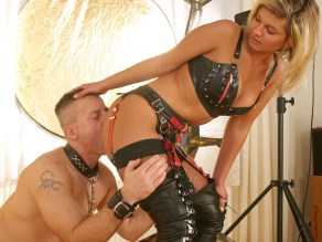 Gorgeous Domina in Thigh High Boots Strap On Fucks a chained male slave