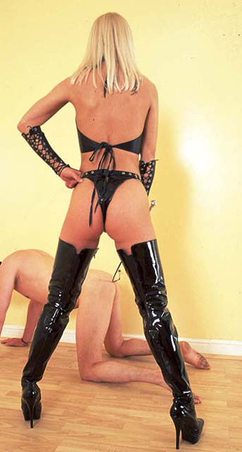 Gorgeous Young Mistress in Latex Boots Whips and Disciplines Her slave