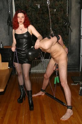Hot Redhead Domina Plays with a naked slave in Dungeon