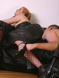 Hot Redhead Dominatrix in Leather Outfit Plays with her young slave