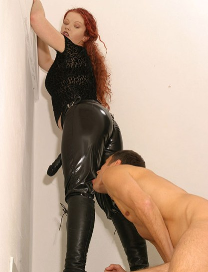 Hot Redhead Mistress in PVC Pants and Military Boots Trains Her slave
