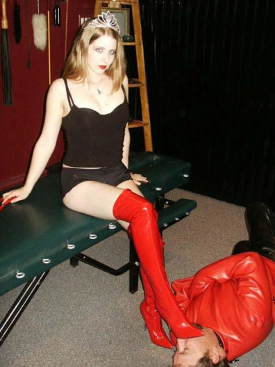 Hot Young Domina Trains a slave in Leather Straitjacket