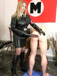 Leather Lady Sidonia Trains a hooded male slave