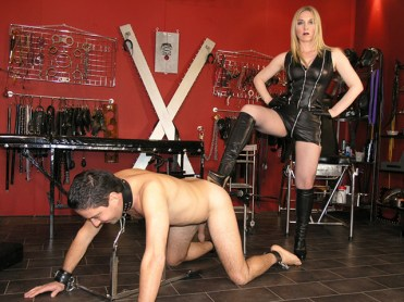 Mistress Sidonia Disciplines and Degrades a naked slave in Her Dungeon